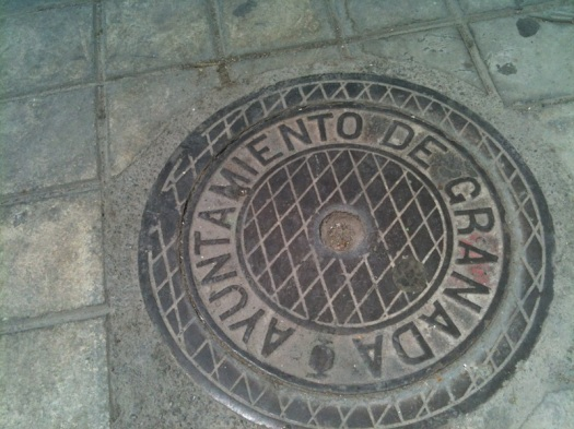 Granada man-hole cover