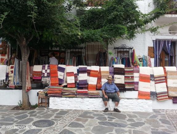 Rugs hanging in Pampaneira